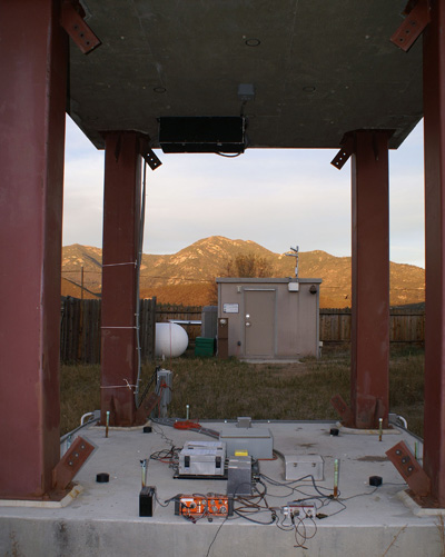 The Soil-Foundation-Structure Interaction test structure with the instrumentation hut and mountains surrounding Garner Valley, California